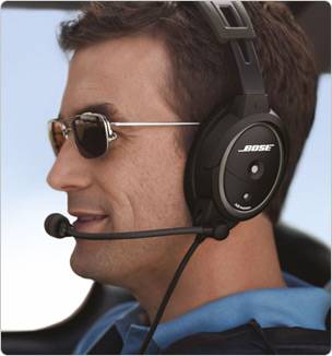 Pilot with Bose headset on in flight